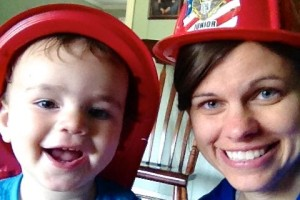mom and son wearing fire fighter hats