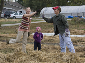 High fives at Food Day Crop Mob (Oct 2011) 273