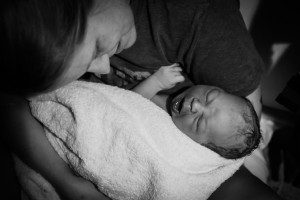 David and Vanessa, just after birth. Dad caught the baby before the midwife and doula could arrive! Photo courtesy of Sacred Hour Doula and Photography, 2014.