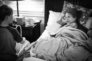 Jude brought his own baby's toy cradle to sit next to Mommy's bed, first offering it to David, then placing his own baby doll in the bed. Photo courtesy of Sacred Hour Doula and Photography, 2014.