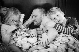 Sophie (left) with David, Josh, and Jude (right) bonding with David while the midwife and her team take care of Vanessa, clean up and make food.