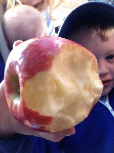 He licked this apple, after finding it on the street at a parade.