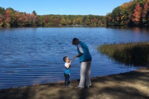 My son and Grammy share a special moment at the hometown pond where generations of my family grew up swimming and skipping rocks.
