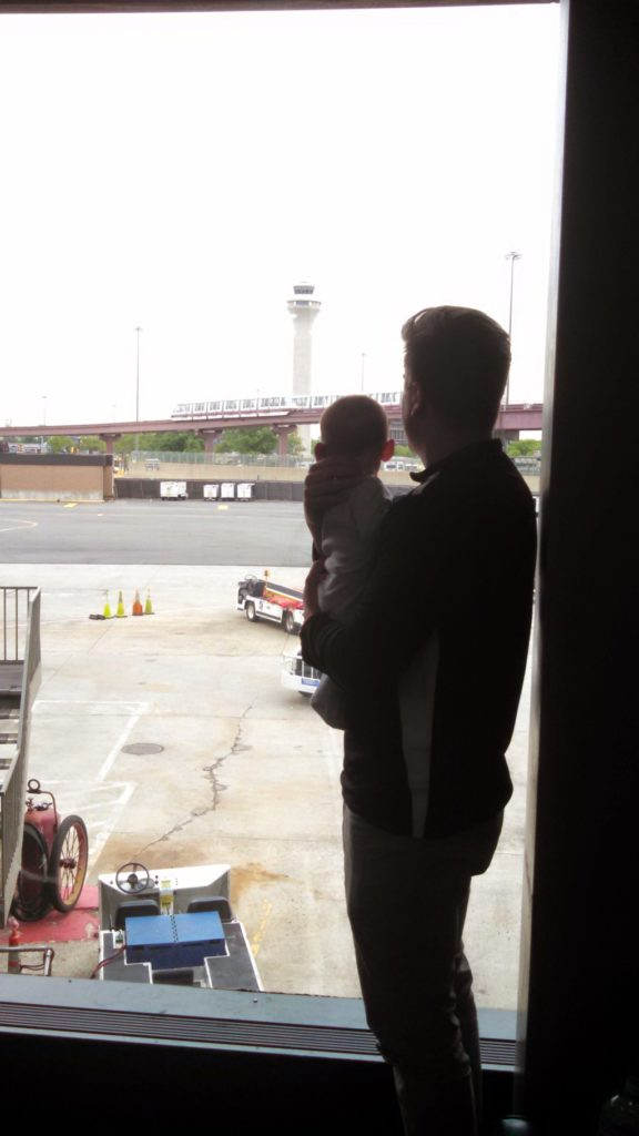 My oldest son and his dad, looking at planes while waiting for his 1st flight. We went to Ithaca, NY for my cousin's graduation from Cornell. My son still loves looking at the planes at the airport.