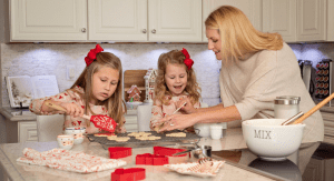 girls and mom making cookies