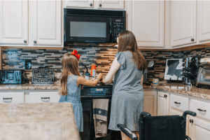 Mother talking to daughter while cooking