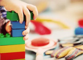 kid building with legos