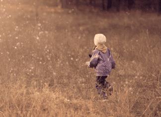 kid walking in field