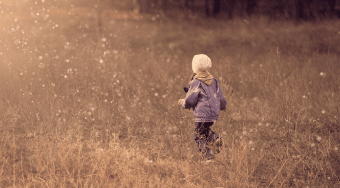 kid walking in field