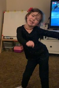 young girl dancing the floss