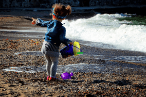 girl playing near water