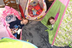 Pic of three siblings having a slumber party