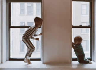 two kids playing inside