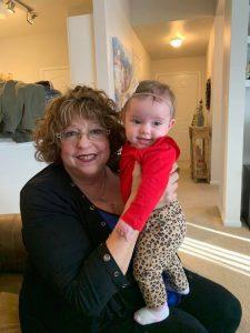 Grandmother holding baby granddaughter