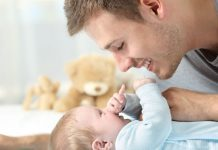 pic of father playing with baby