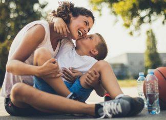 son kissing mom's cheek