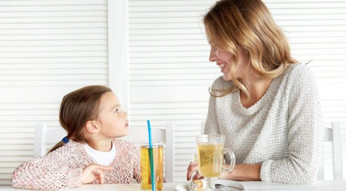 pic of mom and daughter sitting at a table