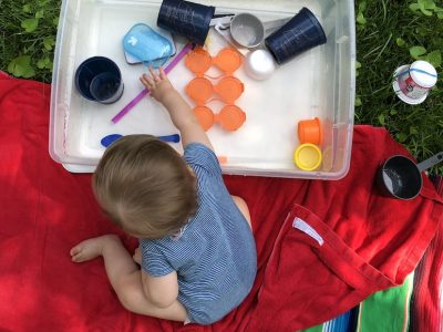pic of toddler playing with DIY watertable
