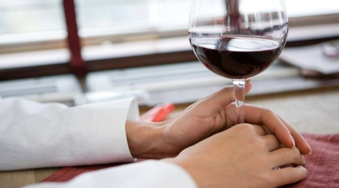 pic of woman's hands holding glass of wine