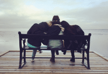 pic of friends sitting on a bench