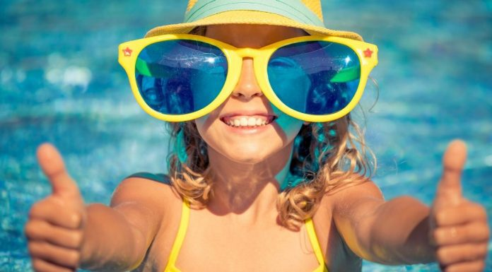 pic of young girl in big sunglasses