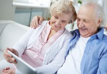 pic of an older couple looking at a tablet together
