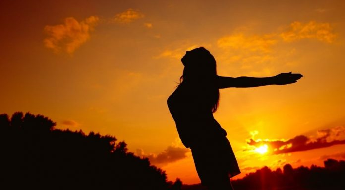 pic of woman's silhouette at sunset