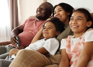pic of family watching tv together