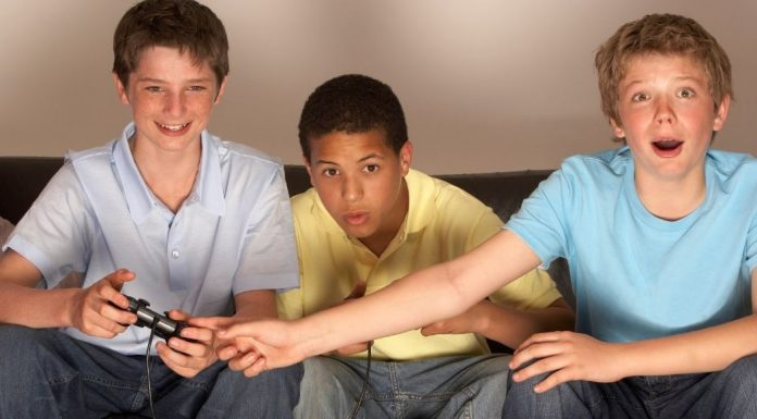 pic of three boys playing video games