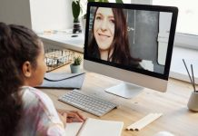 pic of young girl learning remotely with her teacher on the screen