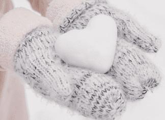 Mittens holding heart