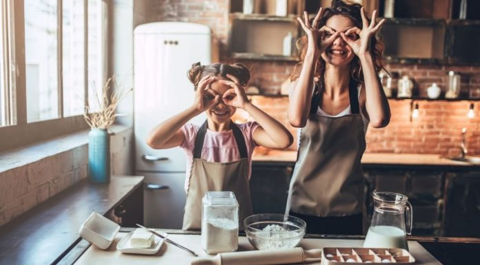 pic of mom and daughter baking in the kitchen