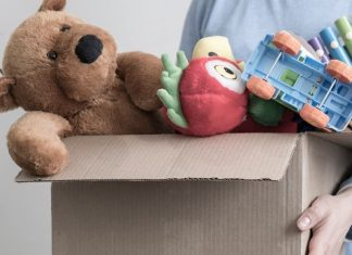 pic of woman holding box of toys