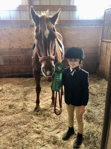 pic of child and horse