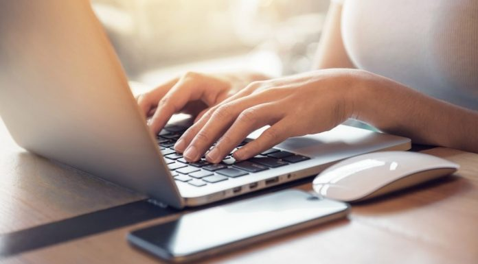 pic of woman typing on laptop