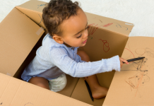 Toddler in Cardboard Box