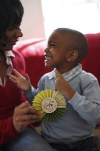 4-year-old boy smiling at his mother