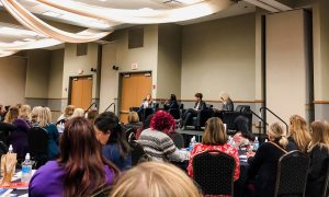 a crowded luncheon about women in leadership