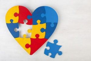 heart made of different colored puzzle pieces