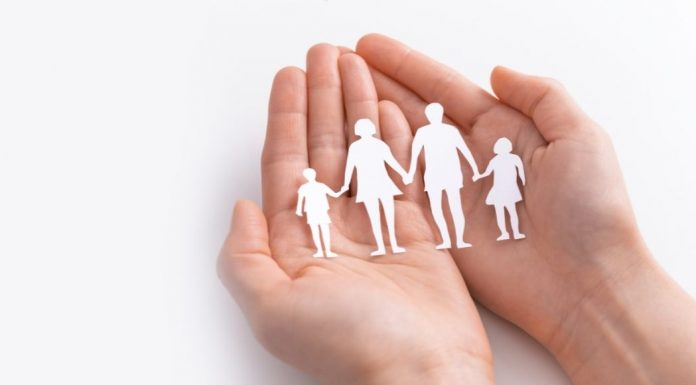 cut out of a family held in two palms