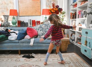 girl dancing in the living room