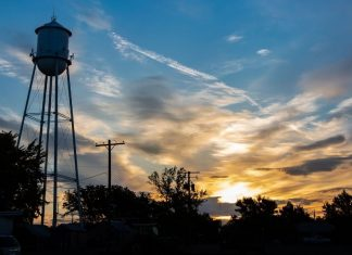 pic of a farm's water tower at sun rise