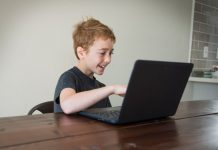 boy doing virtual learning at the kitchen table
