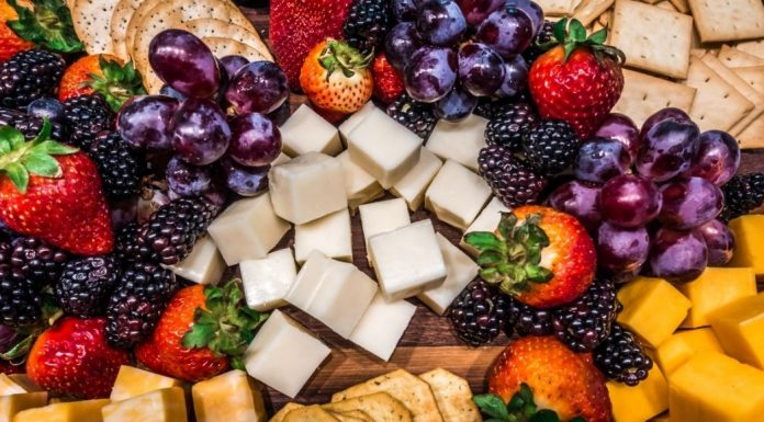 charcuterie board with cheeses and fruit