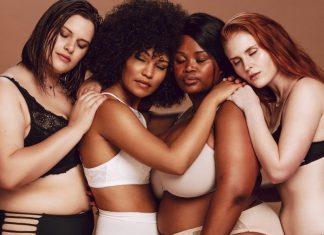 group of diverse women hugging