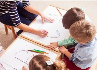 kids coloring at a table