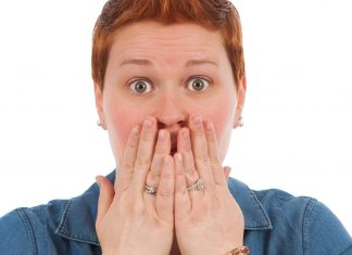 """woman covering her mouth, like in an """"oops"""""""