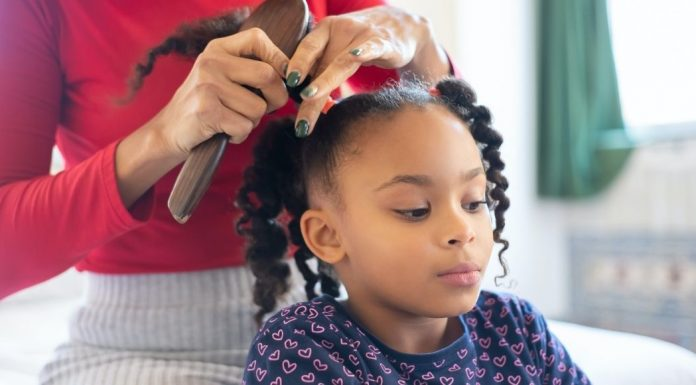 young Black girl getting her hair done