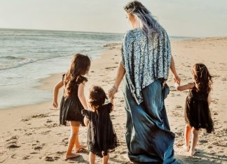 Woman on a beach with her three daughters