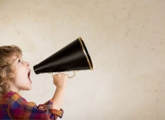 kid speaking out of a megaphone